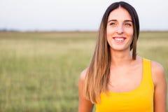Portrait of beautiful woman in meadow Stock Image