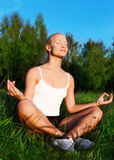 Portrait of a beautiful woman meditating outdoors Royalty Free Stock Image