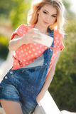 Portrait of a beautiful woman with mobile phone Royalty Free Stock Photos