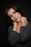 Portrait of a Beautiful Woman Model black background studio - Stock Image Stock Photos