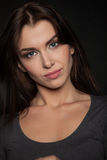 Portrait of a Beautiful Woman Model black background studio - Stock Image Royalty Free Stock Images