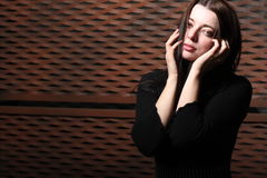 Portrait of beautiful woman with mysterious look Stock Photos