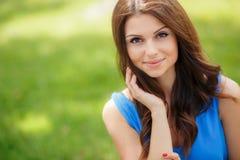 Portrait of beautiful woman on nature background. Stock Photo