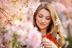 Portrait of beautiful woman near a flowering tree Royalty Free Stock Photography