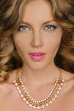 Portrait of beautiful woman with necklace Stock Images