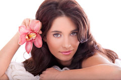 Portrait of beautiful woman with orchid flower Stock Photography