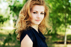 Portrait of a beautiful woman outdoors Royalty Free Stock Photos