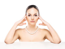 Portrait of a beautiful woman in a pearl necklace Royalty Free Stock Images
