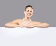 Portrait of a beautiful woman in a pearl necklace Stock Photography