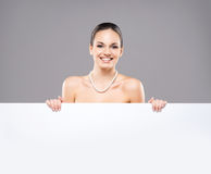 Portrait of a beautiful woman in a pearl necklace Royalty Free Stock Photos