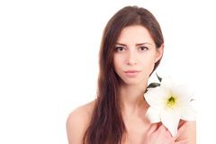 Portrait of beautiful woman with perfect skin holding lily Royalty Free Stock Photos