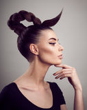 Portrait of beautiful woman with perfect skin and make-up. Creative hairstyle. royalty free stock photography