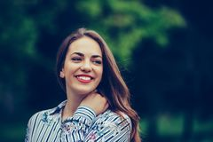 Portrait of a beautiful woman with a perfect smile outdoors royalty free stock photo