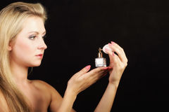 Portrait beautiful woman with perfume bottle Stock Images