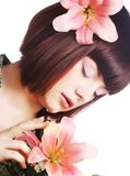 Portrait of beautiful woman with pink lily flower Stock Photos