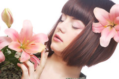 Portrait of beautiful woman with pink lily flower Royalty Free Stock Images