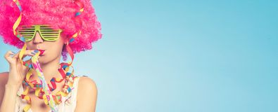 Portrait of beautiful woman in pink wig and green glasses. With copy space royalty free stock photos