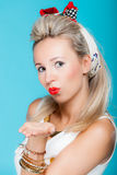 Portrait beautiful woman pinup girl retro style blowing a kiss - flirty on blue Royalty Free Stock Images