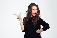 Portrait of a beautiful woman pointing finger away. Isolated on a white background Stock Photo
