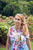 Portrait of beautiful woman posing among blooming asian flowers on Bali island, Indonesia. Stock Images