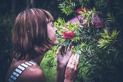 Portrait of beautiful woman posing among blooming asian flowers on Bali island, Indonesia. Stock Photos