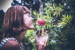 Portrait of beautiful woman posing among blooming asian flowers on Bali island, Indonesia. Royalty Free Stock Photography