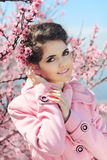 Portrait of Beautiful woman posing over Pink Spring Cherry bloss Royalty Free Stock Photography