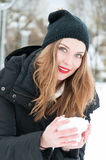 Portrait of beautiful woman posing with snowball Royalty Free Stock Photos