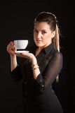 Portrait of beautiful woman posing in studio with cup of coffe. Portrait of sexy woman posing on black background with cup of coffe Royalty Free Stock Photo
