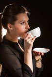 Portrait of beautiful woman posing in studio with cup of coffe. Portrait of sexy woman posing on black background with cup of coffe Stock Photography