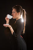 Portrait of beautiful woman posing in studio with cup of coffe. Portrait of sexy woman posing on black background with cup of coffe Royalty Free Stock Photography