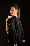 Portrait of beautiful woman posing in studio with jacket. Portrait of sexy rock girl posing in studio with jacket Stock Image