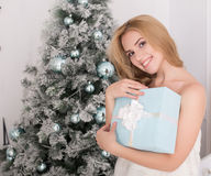 Portrait of beautiful woman with present box  in christmas time Royalty Free Stock Image