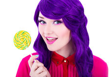 Portrait of beautiful woman with purple hair wig holding colorfu Royalty Free Stock Images