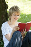 Portrait of beautiful woman reading book Stock Photography