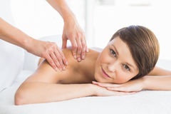 Portrait of beautiful woman receiving back massage Royalty Free Stock Photography