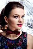 Portrait of beautiful woman with red bow-tie Royalty Free Stock Photo