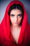Portrait of beautiful woman in red cloth Stock Photos