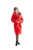 Portrait of the beautiful woman in a red coat Royalty Free Stock Photography