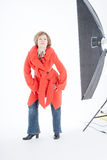 Portrait of the beautiful woman in a red coat Royalty Free Stock Photos