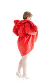 Portrait of the beautiful woman in a red coat Stock Images