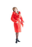 Portrait of the beautiful woman in a red coat Stock Photos