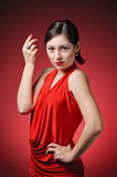 Portrait of a beautiful woman in red dress Stock Photo