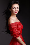 Portrait of beautiful woman in red dress Stock Image