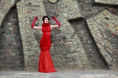 Portrait of beautiful woman in red dress Royalty Free Stock Image