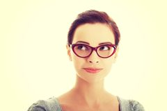 Portrait of beautiful woman in red eyeglasses. Stock Photos
