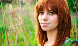 Portrait of a beautiful woman with red hair Stock Photo