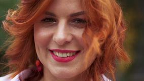 Portrait of a beautiful woman with red hair. Close-up of a woman`s face.