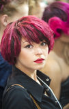 Portrait of beautiful woman with red hair at the hair fashion show. Kiev, Ukraine - September 18, 2014: A model gets ready backstage for the hair fashion show at stock image