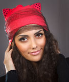 Portrait beautiful woman in a red hat Stock Photography